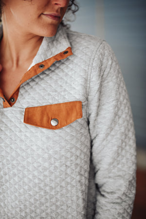 Pocket detail of the oak and ivy quilted pullover.