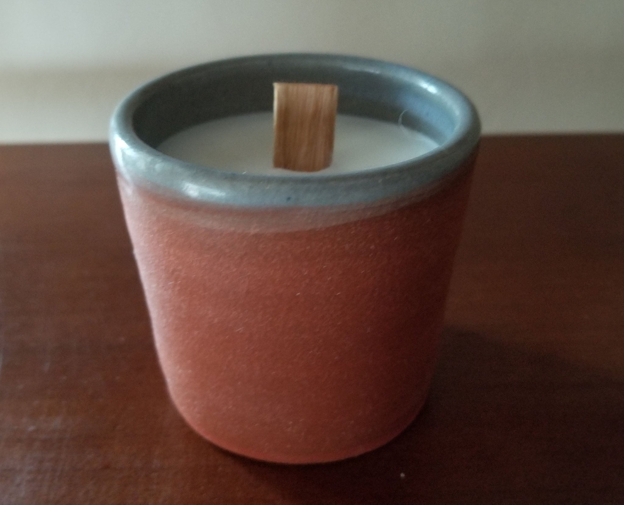 Beeswax candle poured in hand-thrown pottery by Jeremiah Houck.
