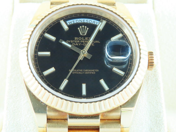 Rolex Day Date 40 mm 18 ct. Yellow Gold Black Motif Dial 228238
