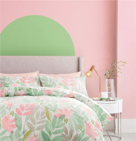 Pink and green bedroom showcasing complimentary colours. Learn more colour theory at Harris Paints.