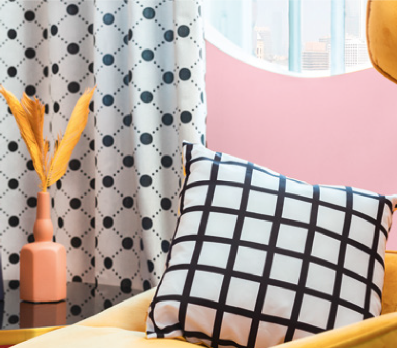 Deco Pink 1141 from Harris Paints in the Caribbean with white and black accent pillows.