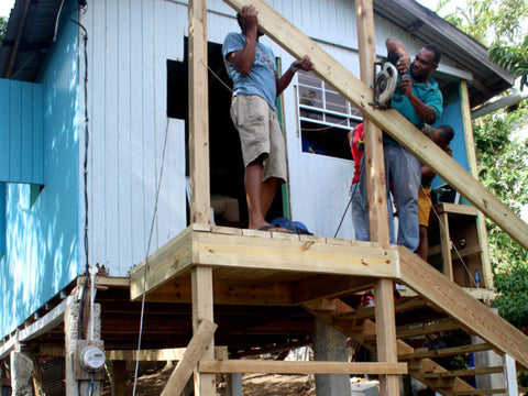 Building stairs at a home in St. Lucia, as part of Vision Express' One Community, One Vision programme.