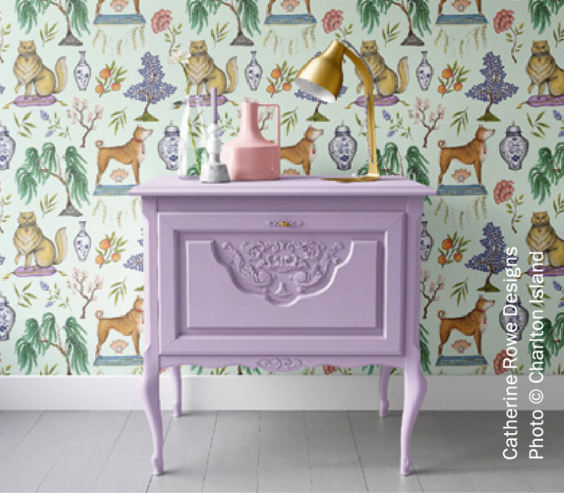 Odyssey Lilac 1218 from Harris Paints in the Caribbean on an end table with lively wallpaper.