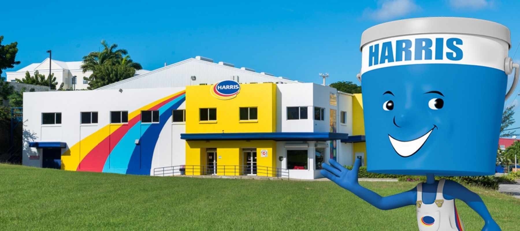 Harris Paints manufactuing facility with little blue man overlayed on top waving