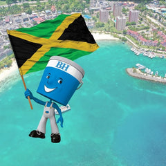scenic image of Jamaica shoreline with BH Paints little blue man holding Jamaican flag