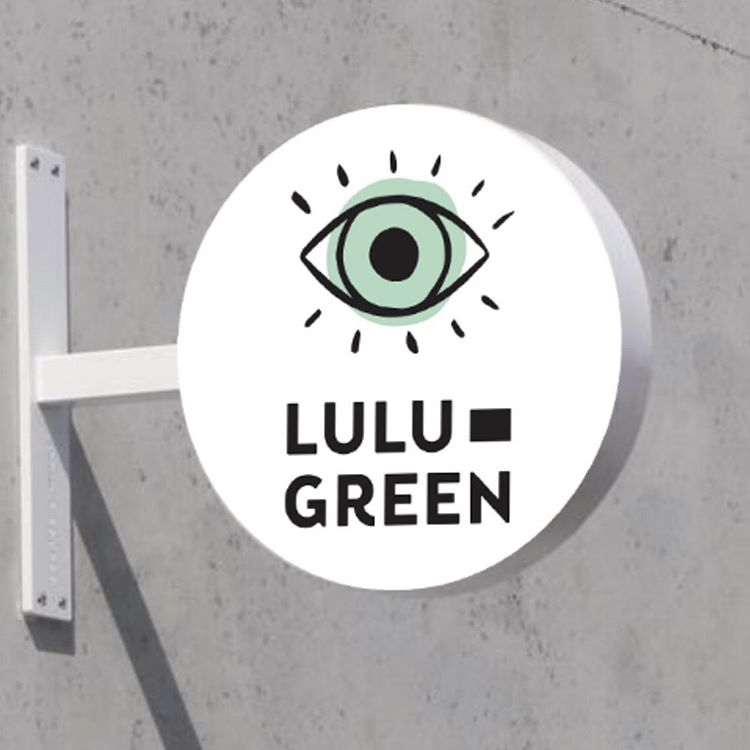 Outdoor round sign for Lulu Green