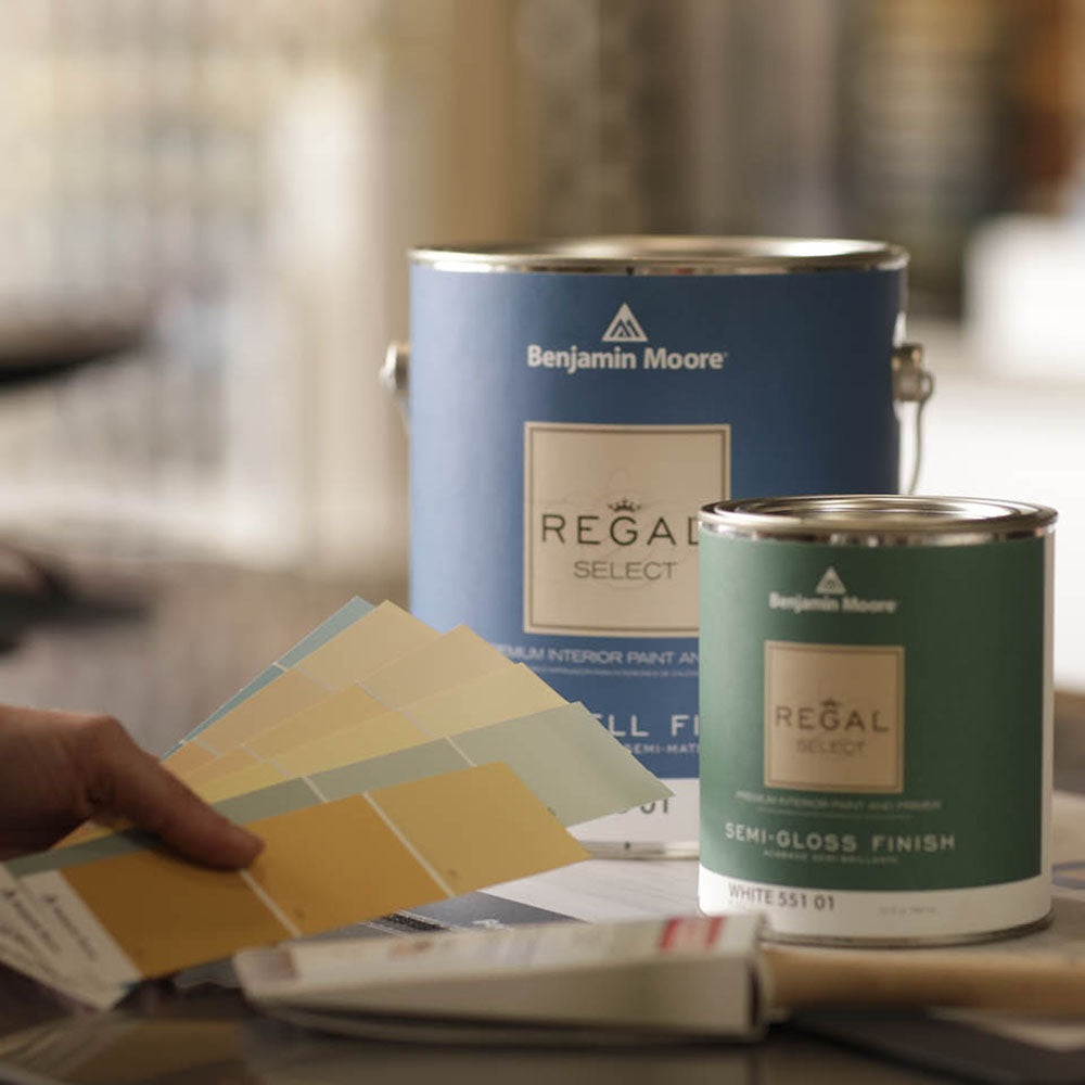 benjamin moore yellow & green color chips featured beside a gallon of regal select paint and a quart of regal select paint