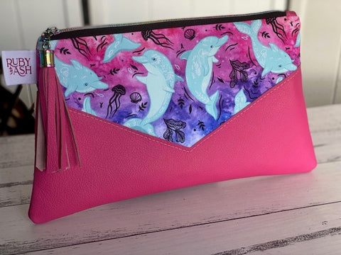 Handmade statement clutch dolphins leather
