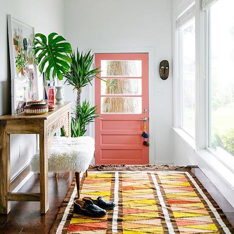 A front door painted with Benjamin Moore's 012 Coral Reef, available at Cincinnati Color Company in Ohio.