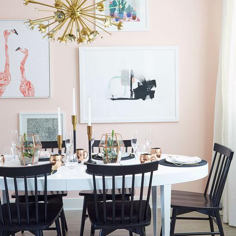 A dining room painted with Benjamin Moore's 1317 Yours Truly, paint color available at Cincinnati Color Company in Ohio.