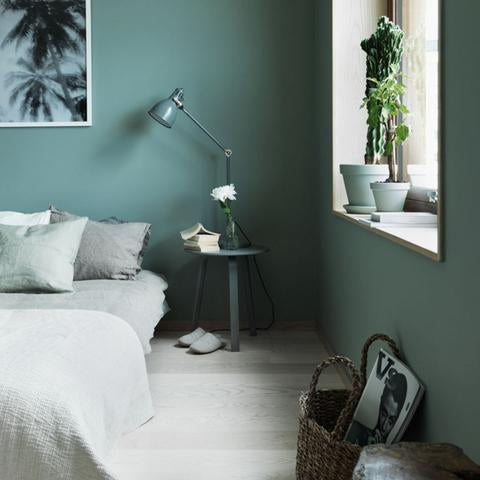 A bedroom painted with Benjamin Moore's 706 Cedar Mountains, paint color available at Cincinnati Color Company in Ohio.