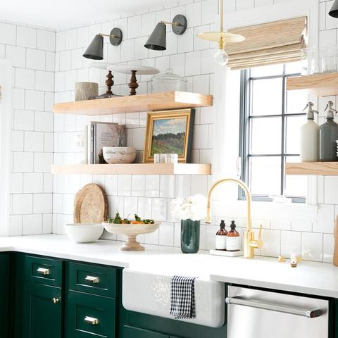 A kitchen with cabinets that have been painted with Benjamin Moore's 2047-10 Forest Green, available at Cincinnati Color Company in Cincinnati, Ohio.