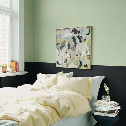 A bedroom with half of the wall painted with Benjamin Moore's HC-120 Van Alen Green, a paint color available at Cincinnati Color Company in Ohio.