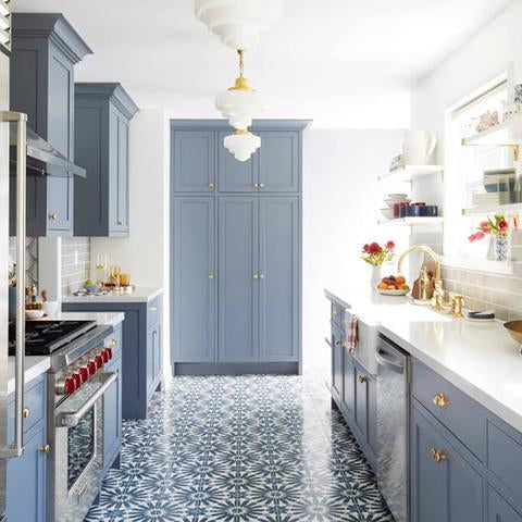 A kitchen with cabinets that have been painted with Benjamin Moore's 2127-40 Wolf Gray, available at Cincinnati Color Company in Cincinnati, Ohio.