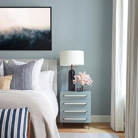 A bedroom wall painted with Benjamin Moore HC-149 Buxton Blue, paint color available at Cincinnati Color Company in Ohio.