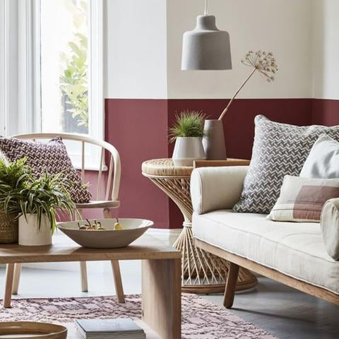 A living room with half of the wall painted with Benjamin Moore HC-61 New London Burgundy, available at Cincinnati Color Company in Ohio.