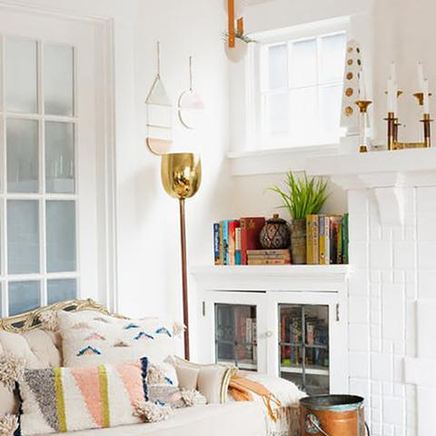 A living room painted Benjamin Moore 2167-70 Summer Peach, a paint color available at Cincinnati Color Company in Ohio.