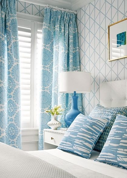Bedroom with wallpaper by Thibaut.
