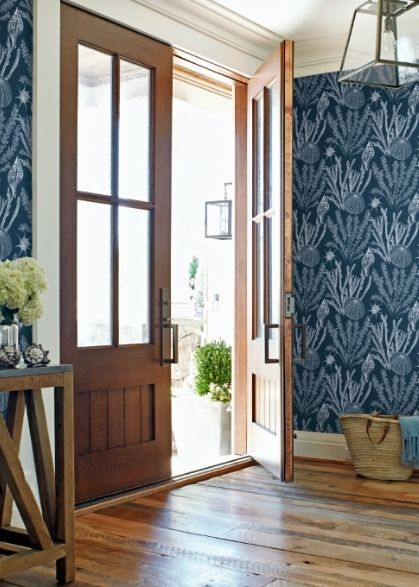 Entrance of a home featuring wallpaper from Wallquest
