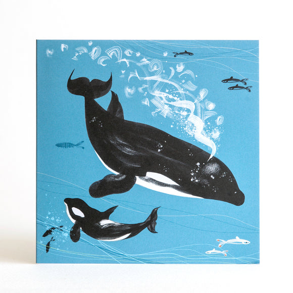 Orca killer whale swimming with her calf in deep blue ocean with fish and bubbles