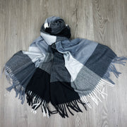 soft acrylic scarf in black white grey check pattern with fringing