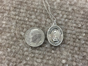 Our Lady Of Kibeho Silver Pendant