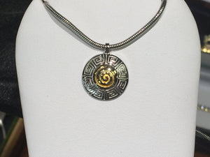 18k and sterling silver pendant and 18 inch long snake chain