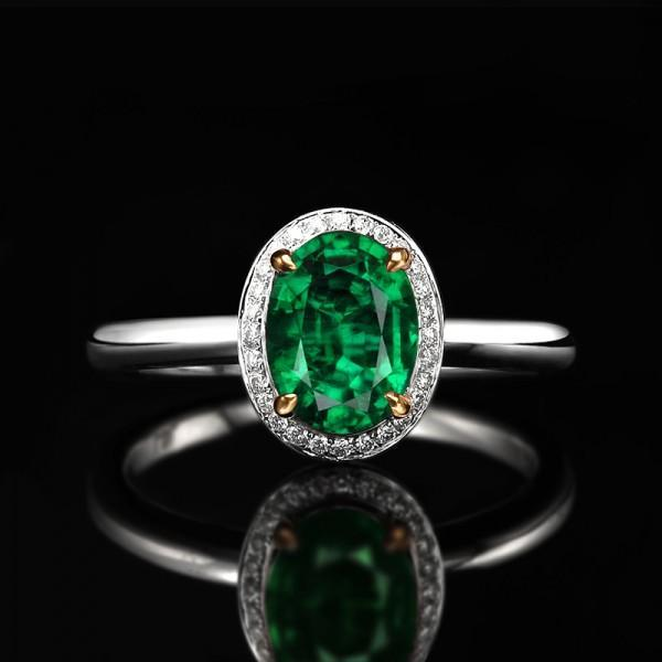 1 Carat oval cut Emerald and Diamond Halo Engagement Ring