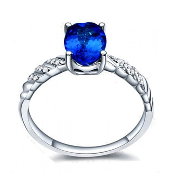 1.25 Carat Oval Cut Sapphire and Diamond Halo Engagement Ring