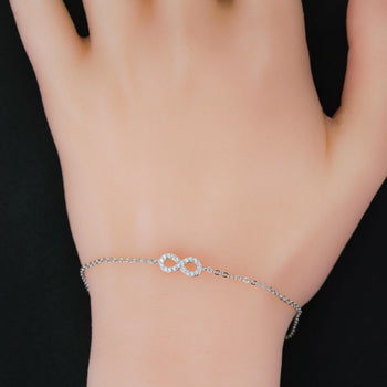 Infinity Inspired .15 Carat Round Cut Diamond Chain Bracelet in Silver