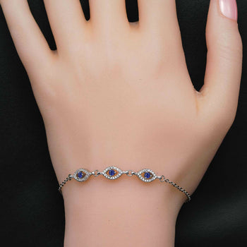 Trilogy Evil Eye .50 Carat Round Cut Diamond and Sapphire Link Bracelet in Silver