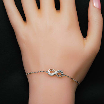 Infinity Styled .15 Carat Round Cut Diamond Link Bracelet in Silver