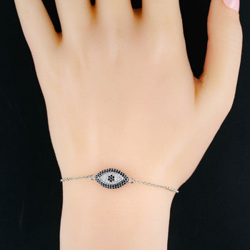 Evil Eye Design .50 Carat Round Cut Black and White Diamond Link Bracelet in Silver