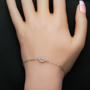 Solitaire .25 Carat Pear Shape Morganite and Diamond Halo Chain Bracelet in Silver