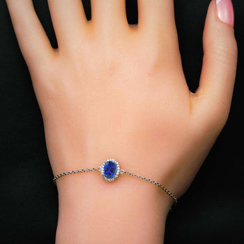 Single Oval Shape .50 Carat Round Cut Diamond Accent Frame and Sapphire Chain Bracelet in Silver