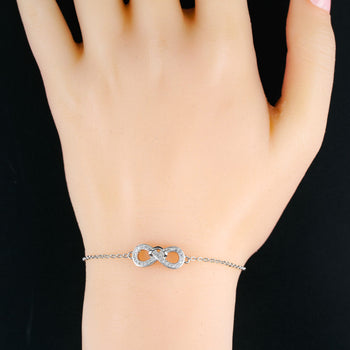 Infinity Twisted .25 Carat Round Cut Diamond Friendship Bracelet in Silver