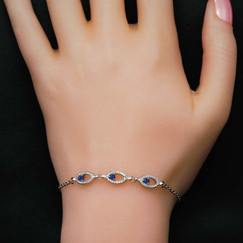 Oval Shape .50 Carat Round Cut Diamond and Three Stone Sapphire Chain Bracelet in Silver