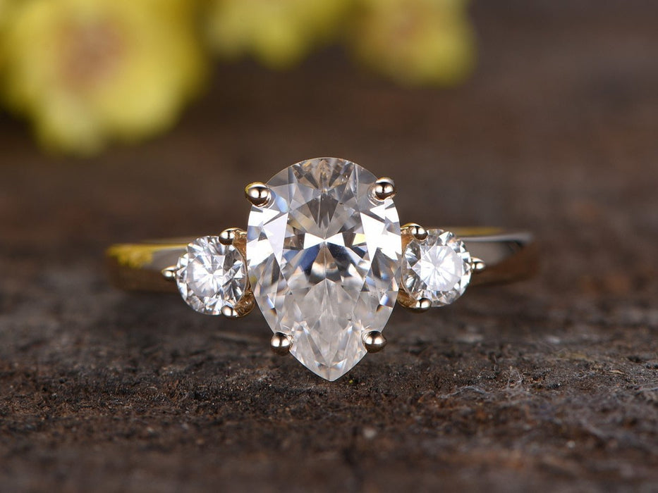 3 Stone Trilogy Pear Cut Moissanite and Diamond 1.25 carat Engagement Ring in White Gold