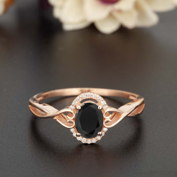 1.25 Carat Oval Cut Black Diamond and Diamond Engagement Ring in Rose Gold for Modern Brides