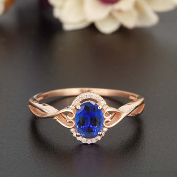 1.25 Carat Oval Cut Sapphire and Diamond Engagement Ring in Rose Gold for Modern Brides