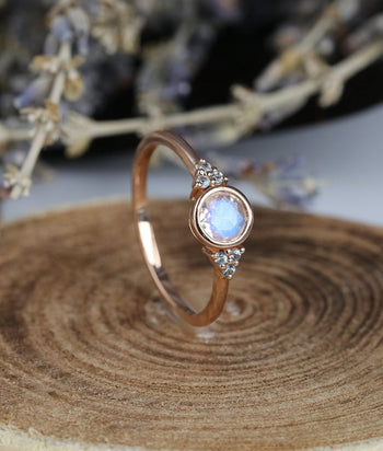 Seven Stone 1.10 Carat Round Cut Rainbow Moonstone and Diamond Bezel Engagement Ring in Rose Gold