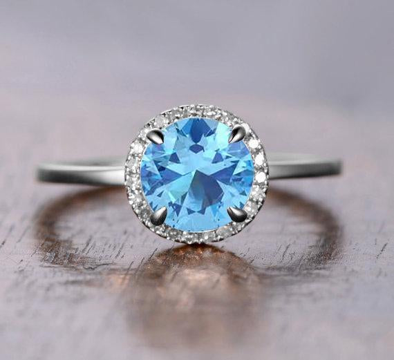 1.25 Carat Round Cut Aquamarine and Diamond Halo Engagement Ring in White Gold