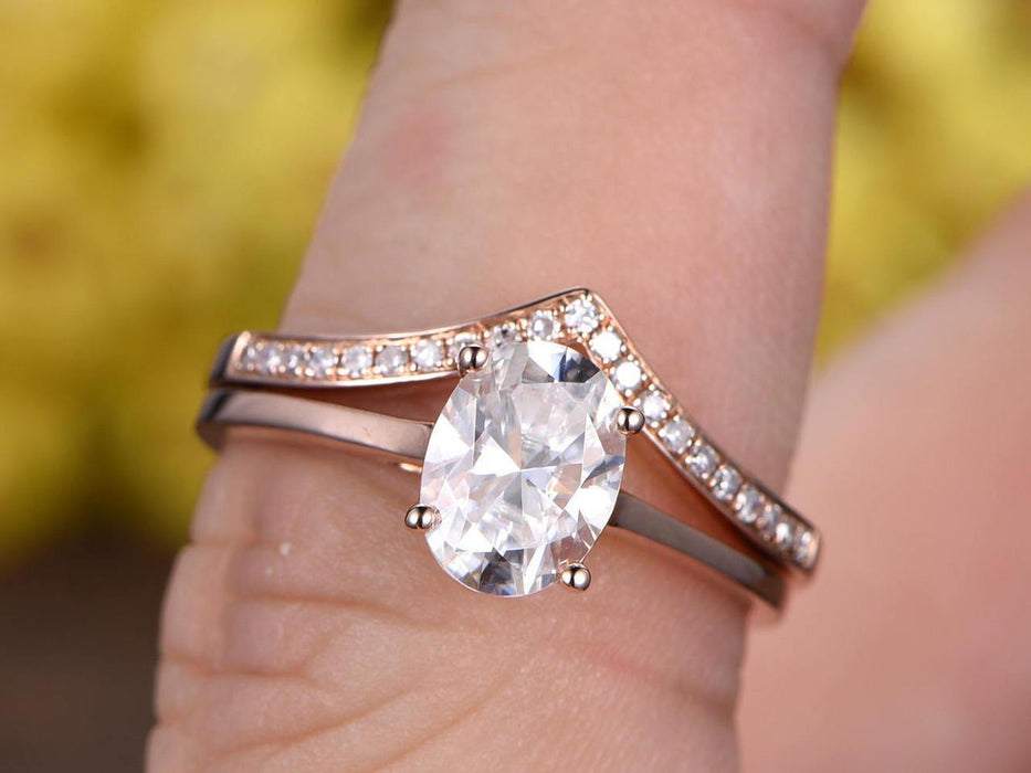 1.25 Carat Oval Cut Moissanite and Diamond Wedding Set in Rose Gold