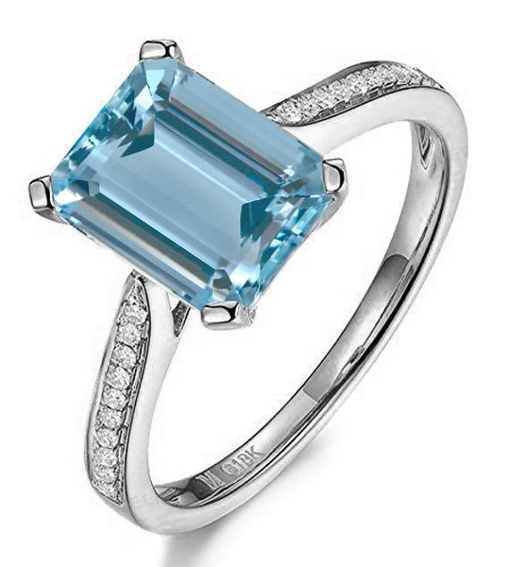 Beautiful 1.25 Carat emerald cut Aquammarine and Diamond engagement Ring in White Gold