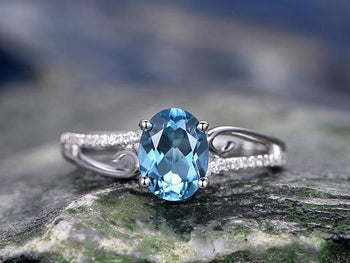 Antique 1.25 Carat Oval Cut Aquamarine and Diamond Engagement Ring in Rose Gold