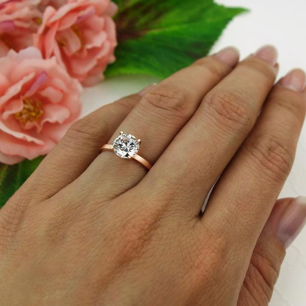 Four Prongs 1.5 Carat Round Cut Solitaire Engagement Ring in Rose Gold Over Sterling Silver