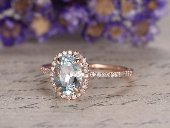 1.50 Carat Oval Cut Aquamarine and Diamond Halo Engagement Ring in Rose Gold