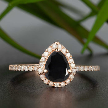 1.25 Carat Pear Cut Black Diamond and Diamond Engagement Ring in Rose Gold for Modern Brides