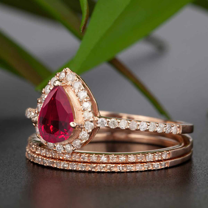 2 Carat Pear Cut Ruby and Diamond Trio Wedding Ring Set in 9k Rose Gold for Modern Brides