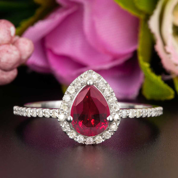 1.25 Carat Pear Cut Ruby and Diamond Engagement Ring in 9k White Gold for Modern Brides